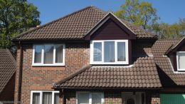 rosewood UPVC shiplap cladding fascias soffits UPVC brown guttering