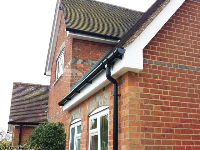 White fascia soffit, black round guttering replacement