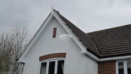 Cement mortar repointing on gable end new bargeboards with GRP roof spire