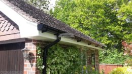 Replacement fascias and soffits with black ogee guttering on a detached garage