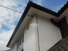 New full installation of UPVC plain soffit with black fascia and guttering