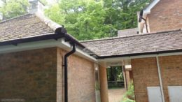 White fascias soffits black guttering on linked garage