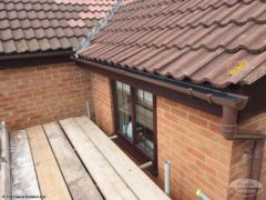 brown guttering with upvc fascias