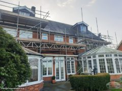 scaffolding above large conservatories