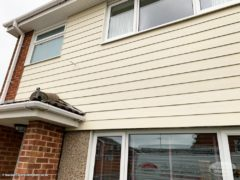 Sail cloth weatherboard cladding installation